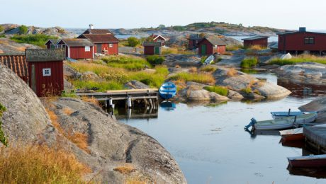The first rays of the morning sun hit the cottages on a small island in the outer archipelago.